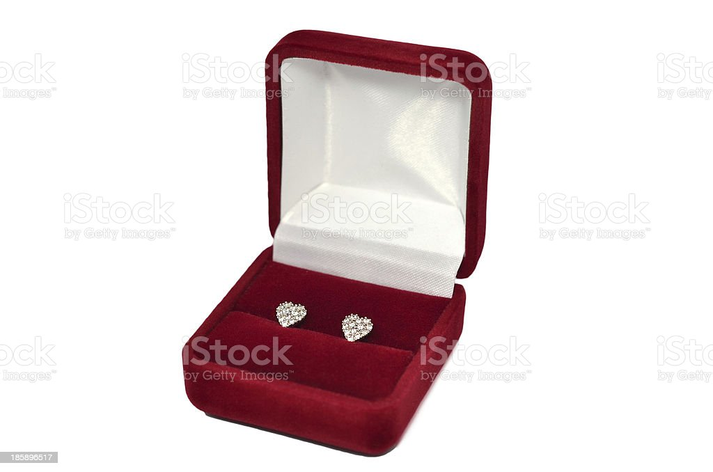 Diamond heart shaped earrings in red jewel box royalty-free stock photo