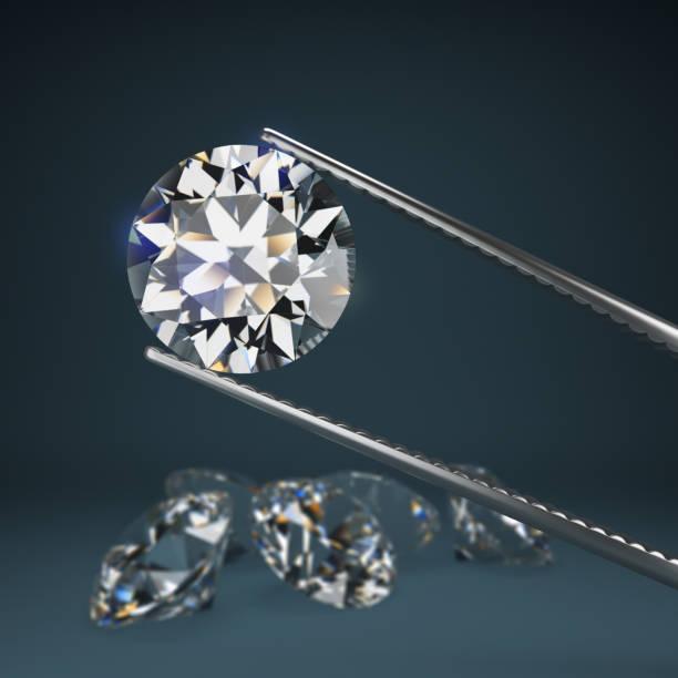 Cтоковое фото diamond in tweezers