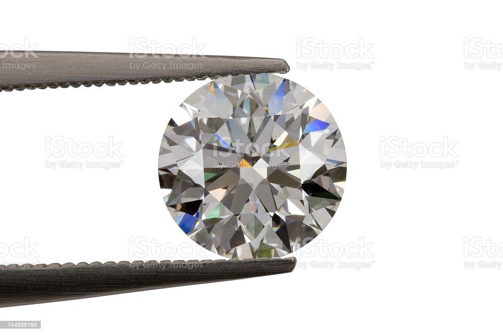 Diamond in tweezers royalty-free stock photo