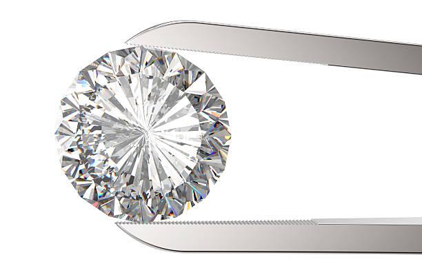 Diamant in die Pinzette – Foto