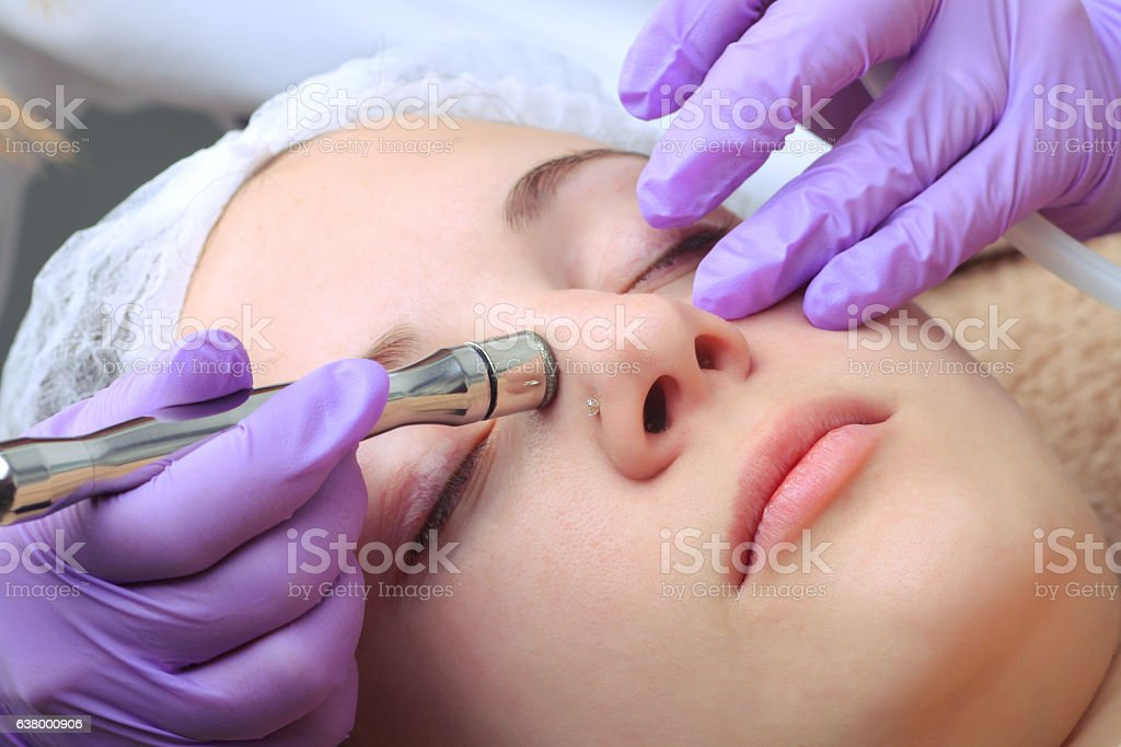 Diamond microdermabrasion, peeling cosmetic. woman during a micr stock photo