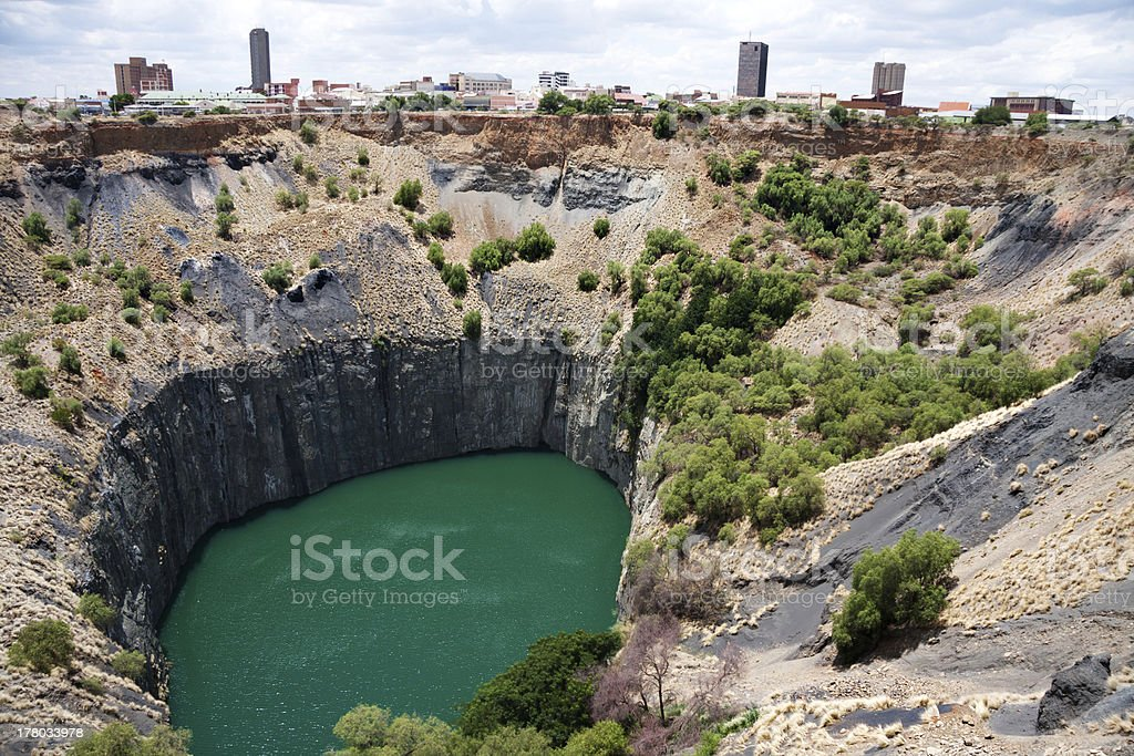 A diamond mine that slopes into a small water source stock photo