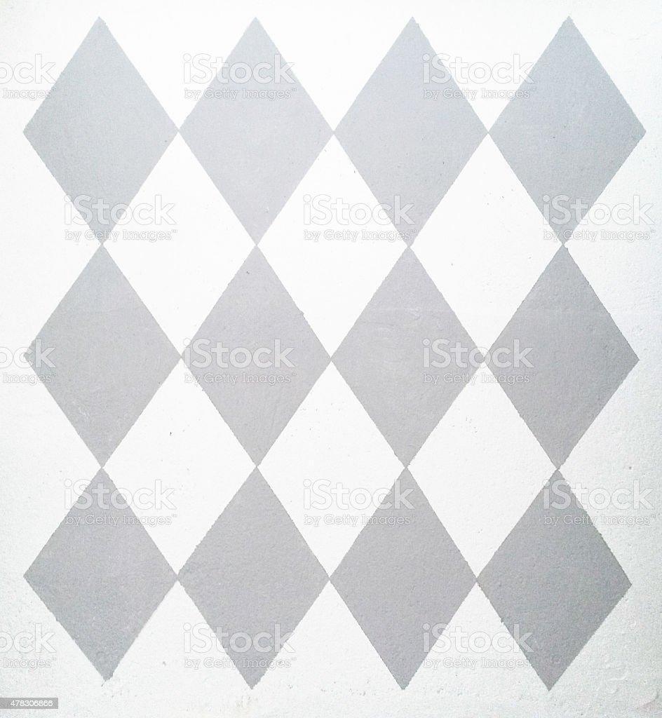Diamond pattern on stucco stock photo