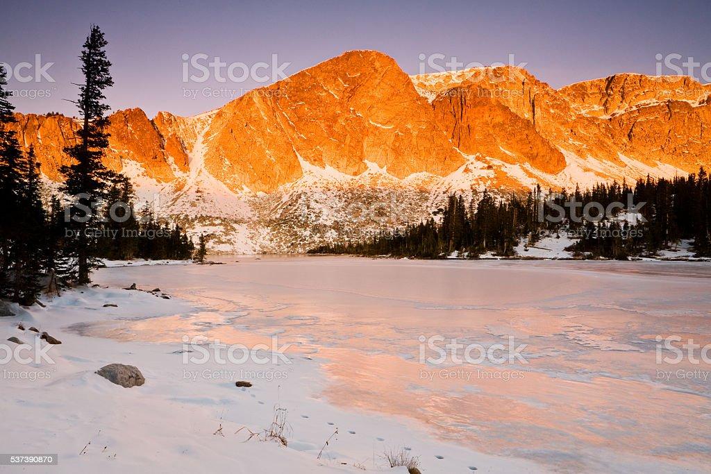 Diamond Peak rising above Lake Marie stock photo
