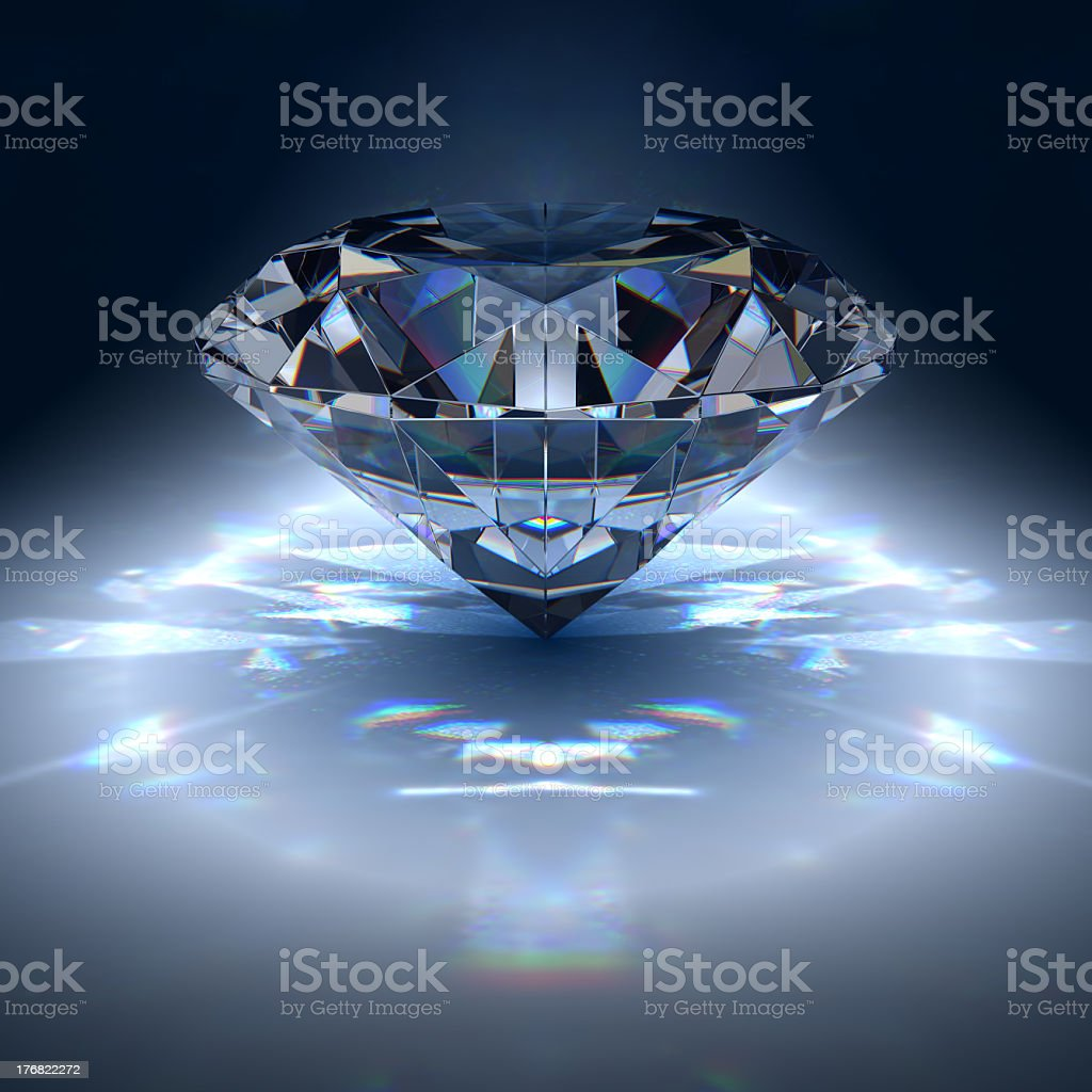 Diamond reflecting several lights on dark background stock photo