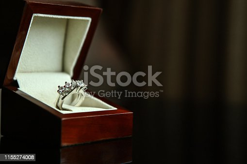 948081716 istock photo Diamond ring in brown box 1155274008