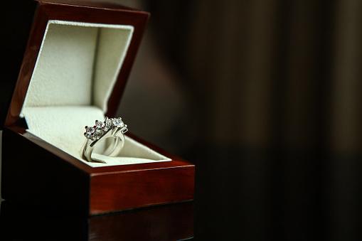 155315629 istock photo Diamond ring in brown box 1155274008