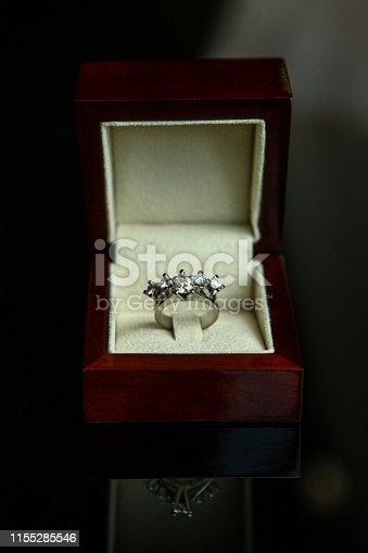 155315629istockphoto Diamond ring in brown box 1155285546