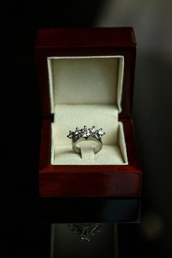 155315629 istock photo Diamond ring in brown box 1155285546