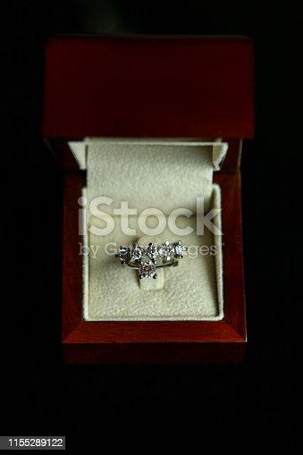 155315629istockphoto Diamond ring in brown box 1155289122