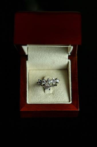 155315629 istock photo Diamond ring in brown box 1155289122