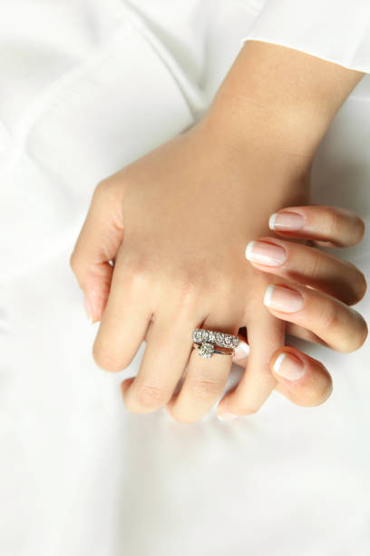 diamond ring in woman's hand - diamond ring hand stock photos and pictures
