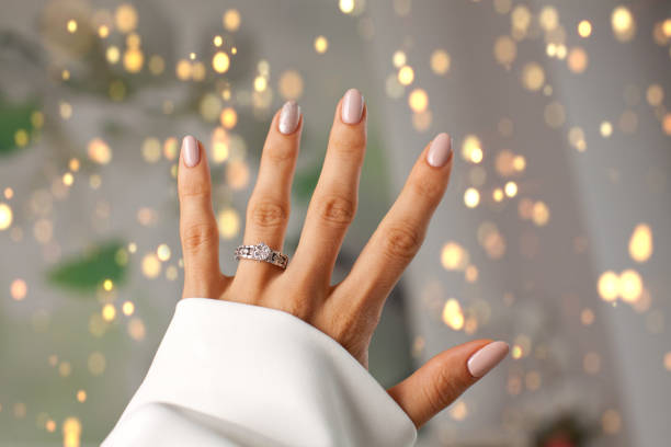 diamond ring on a finger. - diamond ring hand stock photos and pictures