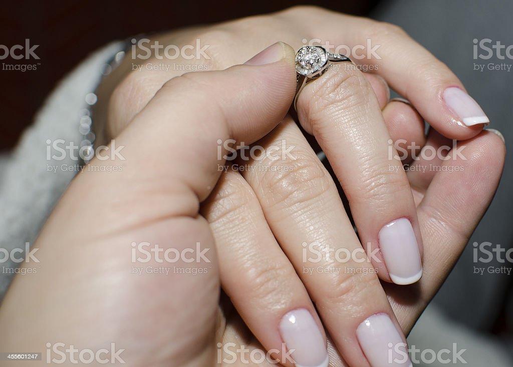 Diamond ring on bride's finger stock photo