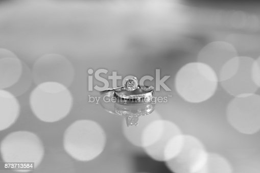 948081716 istock photo Diamond Ring on Glass Table 873713584