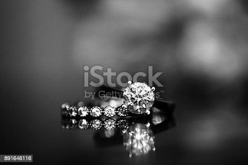948081716 istock photo Diamond Ring on Glass Table 891646116