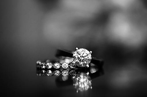 istock Diamond Ring on Glass Table 891646116