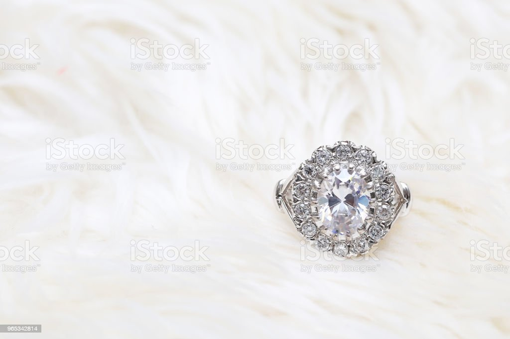 diamond ring on white fabric zbiór zdjęć royalty-free