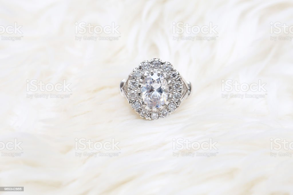 diamond ring on white fabric zbiór zdjęć royalty-free