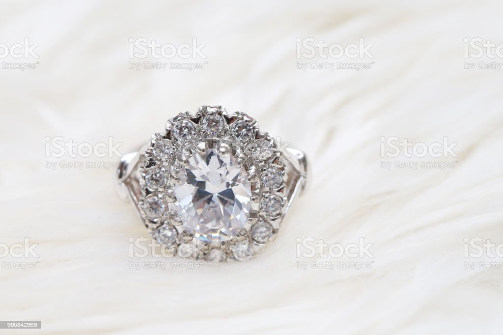 diamond ring on white fabric royalty-free stock photo