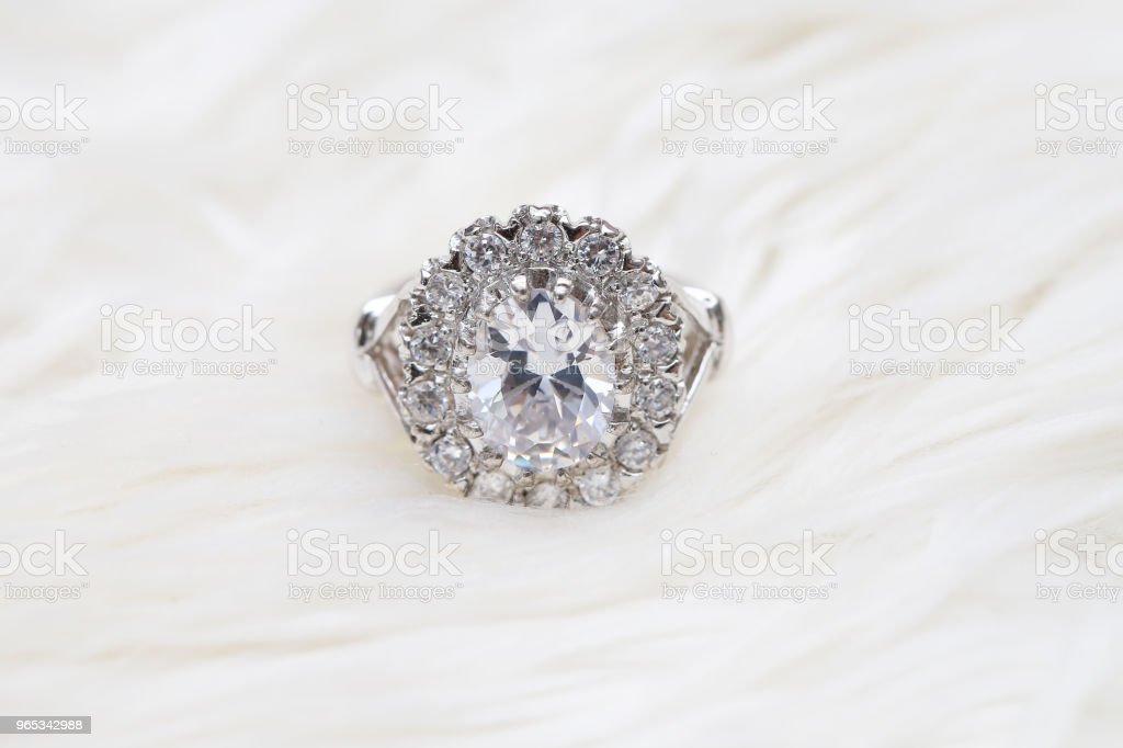 diamond ring on white fabric royalty-free stock photo