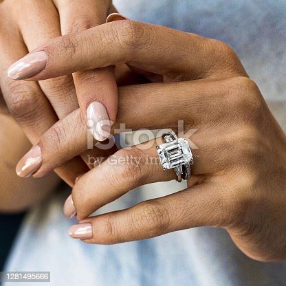 Woman hands using luxury diamond ring in his fingers