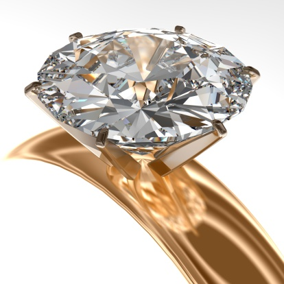 A beautiful gold diamond encrusted ring isolated on white.
