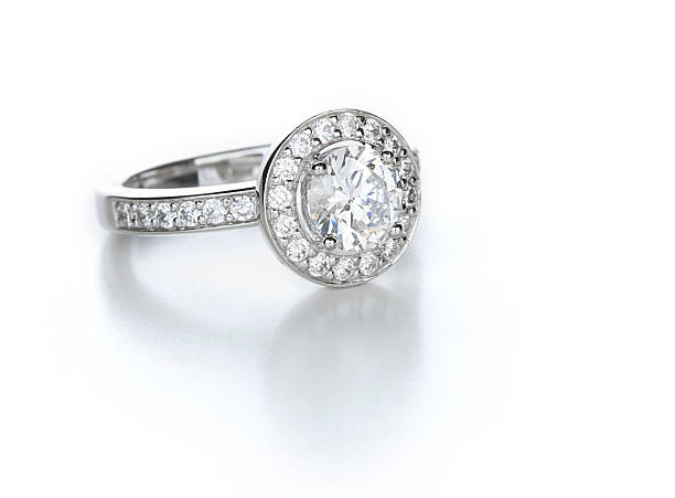 Diamond Ring A contemporary diamond ring. Round brilliant center stone with pave accents. ring jewelry stock pictures, royalty-free photos & images