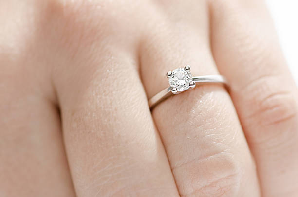 diamond ring - diamond ring hand stock photos and pictures
