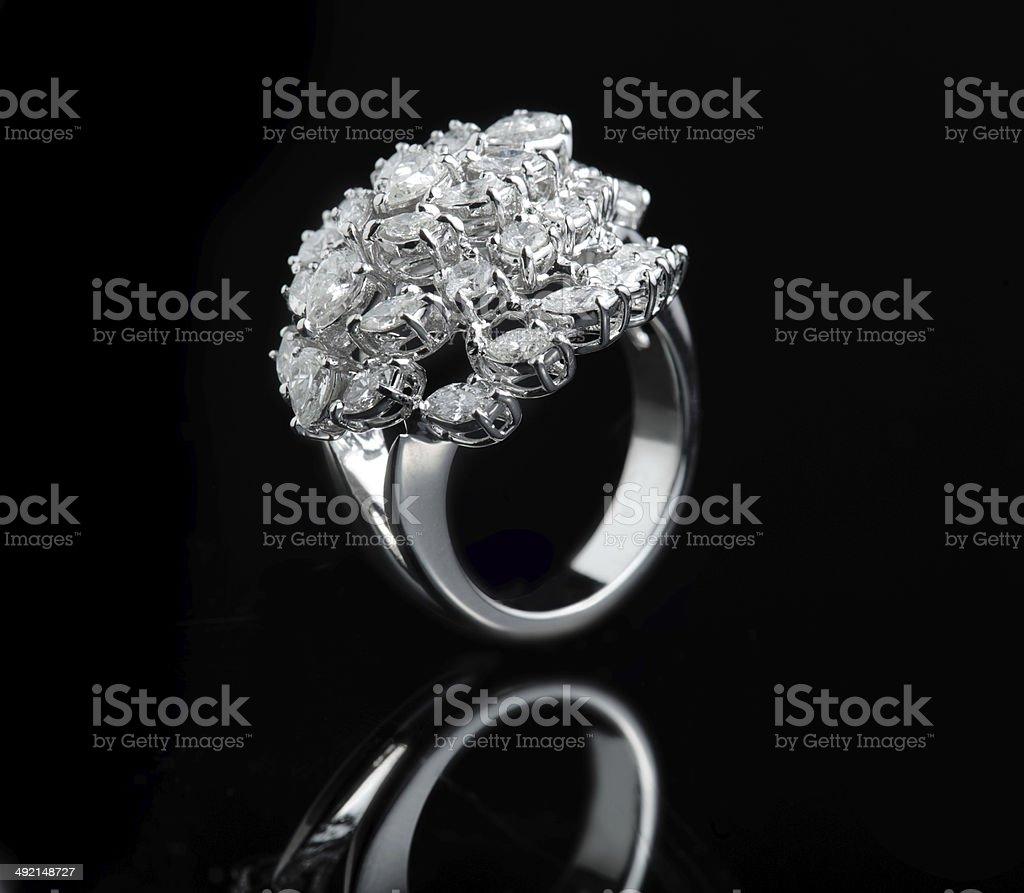 d8b9083d Diamond ring shot on a black reflective background royalty-free stock photo