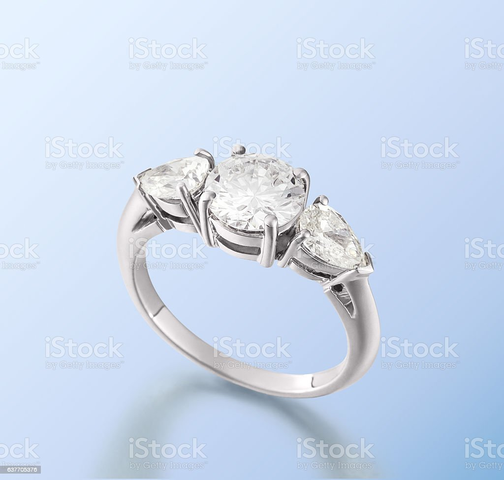 Diamond Ring stays on the blue surface stock photo