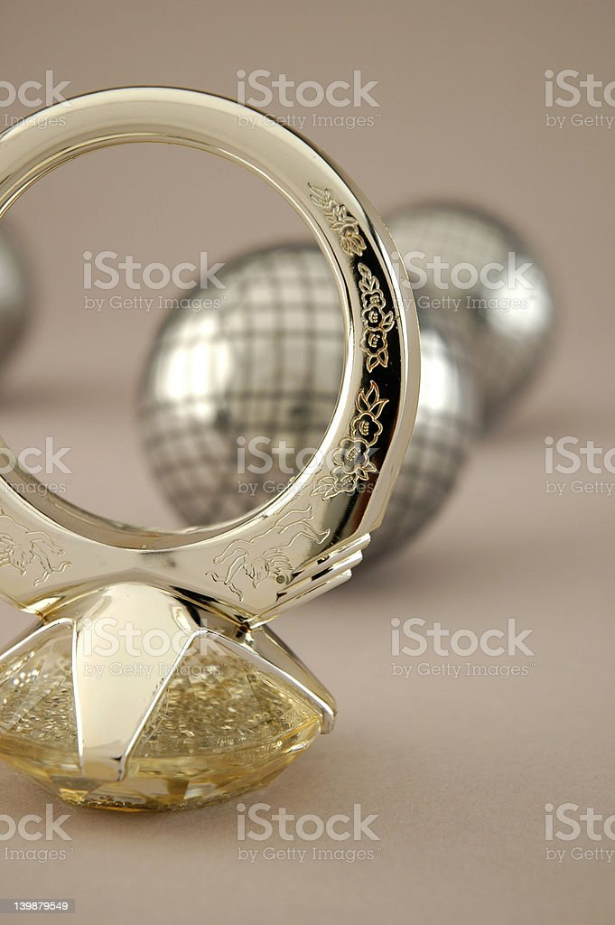 Diamond ring with steel balls background royalty-free stock photo