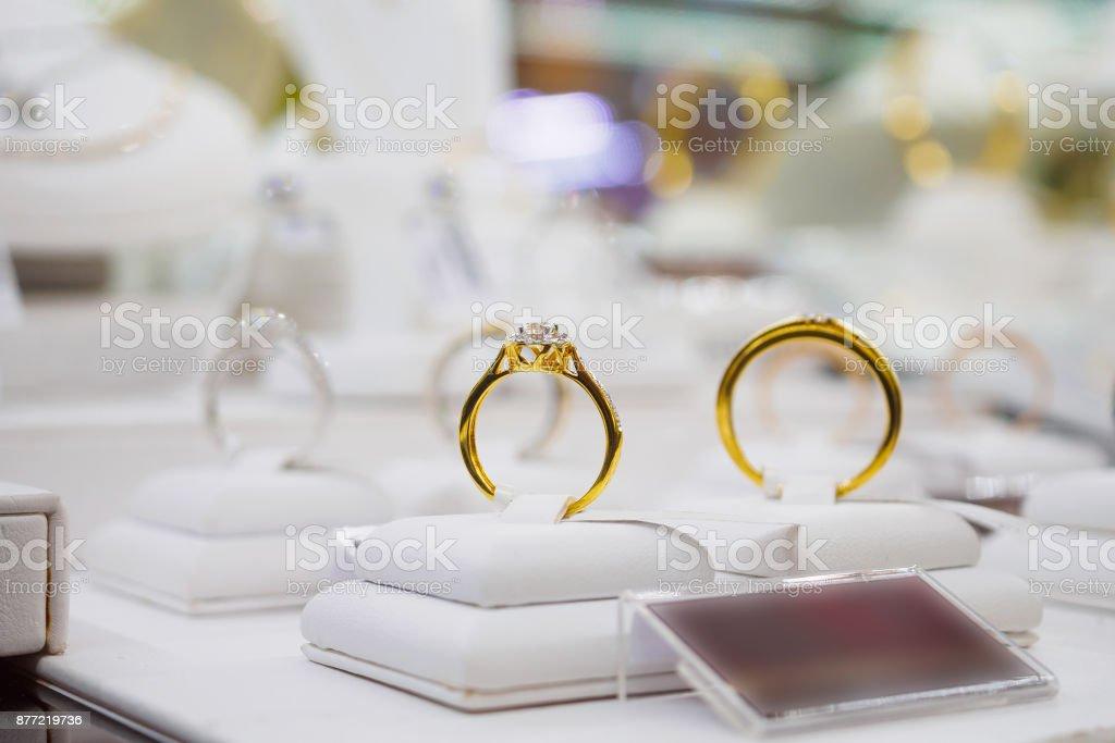 Diamond rings in jewelry luxury store window display stock photo
