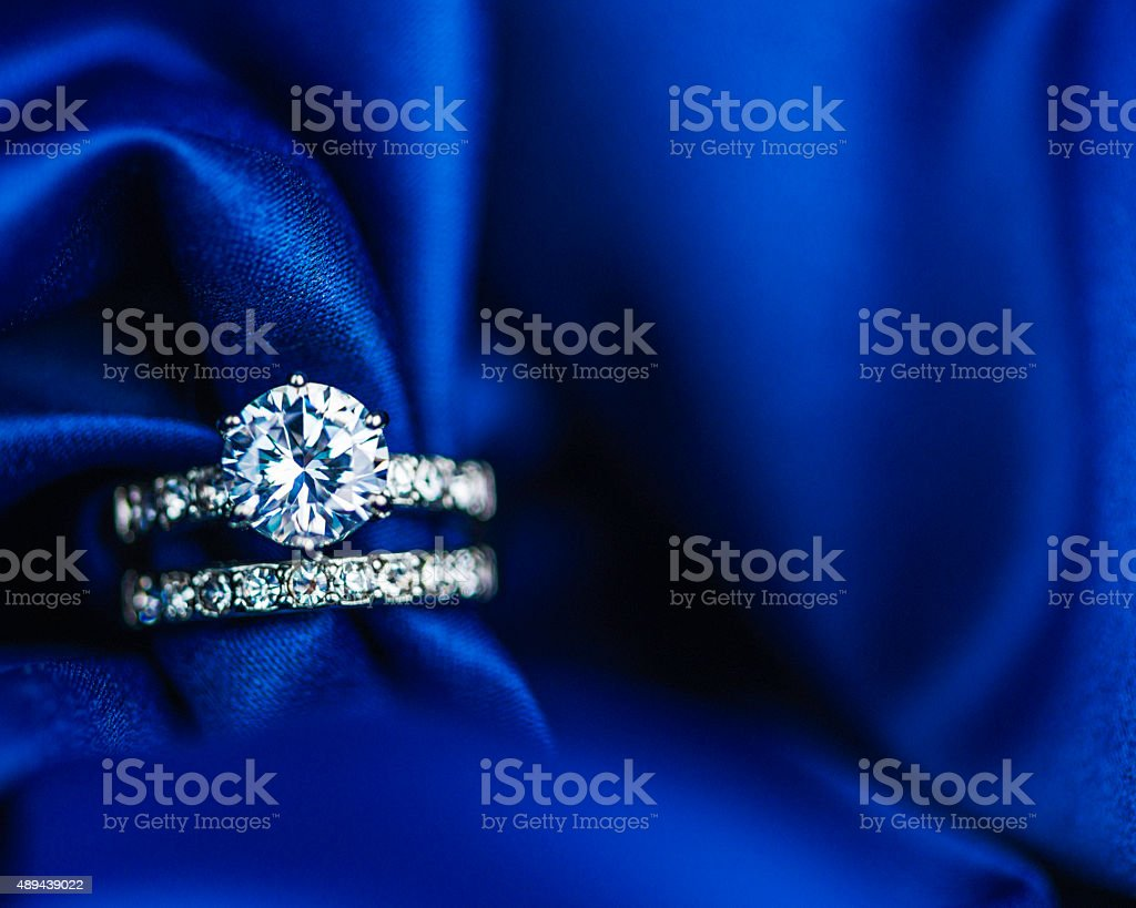 Diamond rings on rich satin background stock photo
