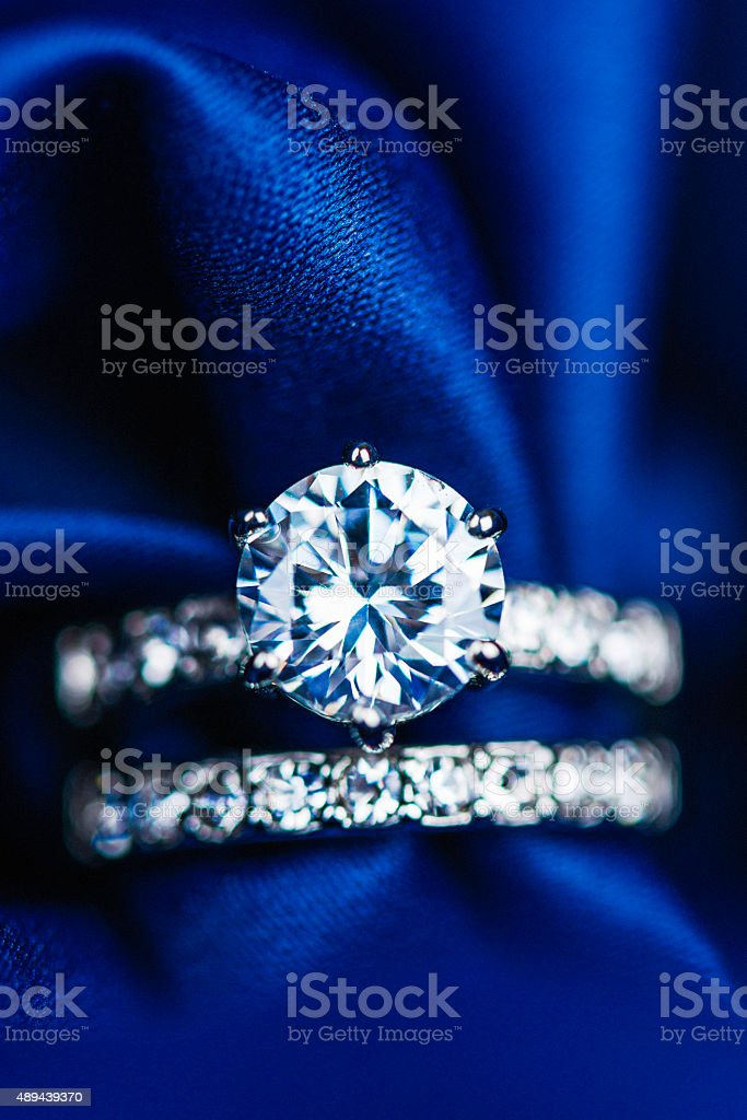 Diamond rings on rich satin background stock photo