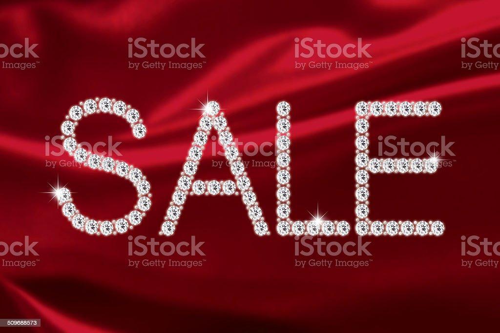 Diamond SALE on red satin stock photo