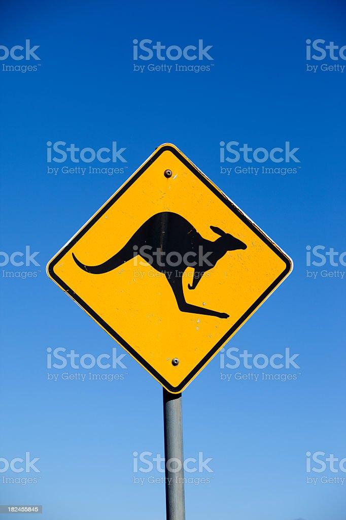 Diamond shaped yellow kangaroo sign on clear blue sky royalty-free stock photo