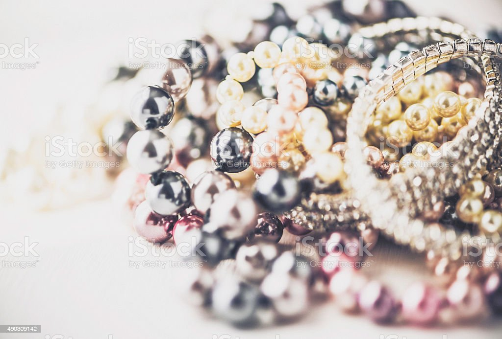 Diamonds and pearls jewelry collection on white desk stock photo