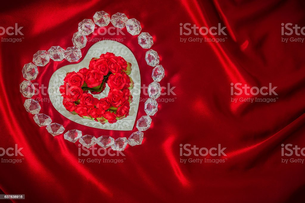 Diamonds and Roses outline a  heart mirror on red  (P) stock photo