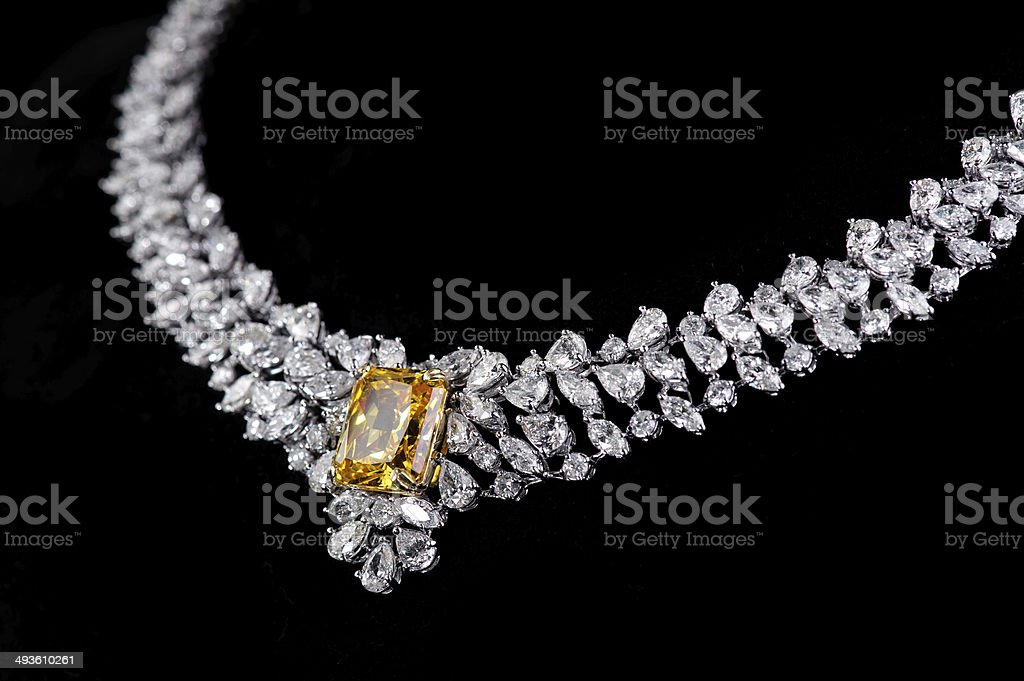 diamonds necklace shot against a black background stock photo