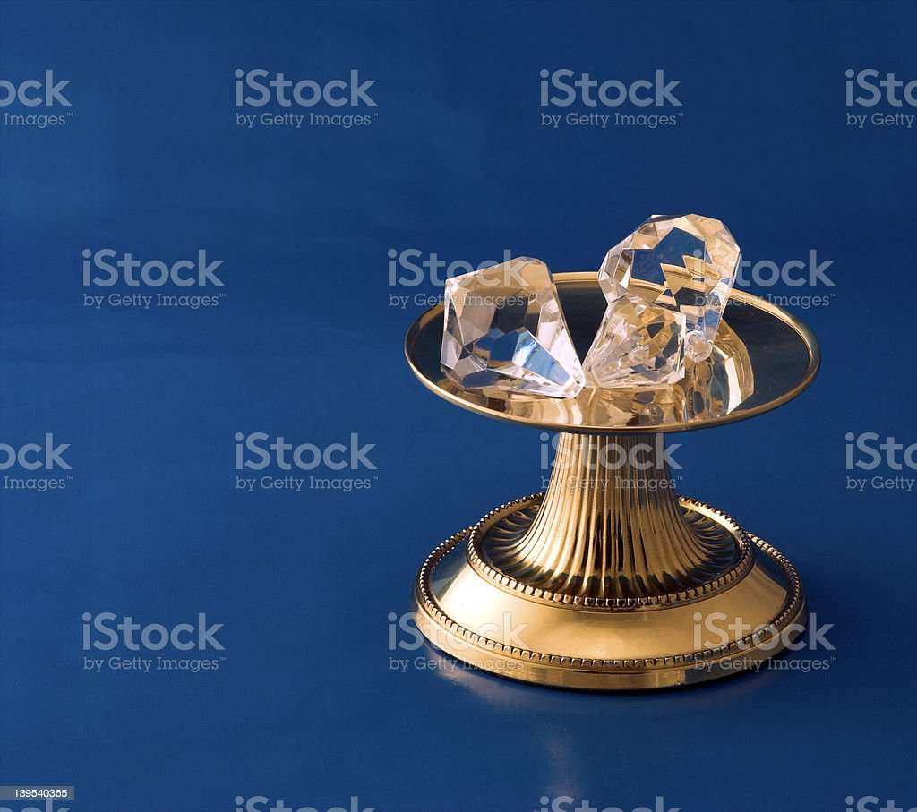 Diamonds On Gold Pedestal royalty-free stock photo
