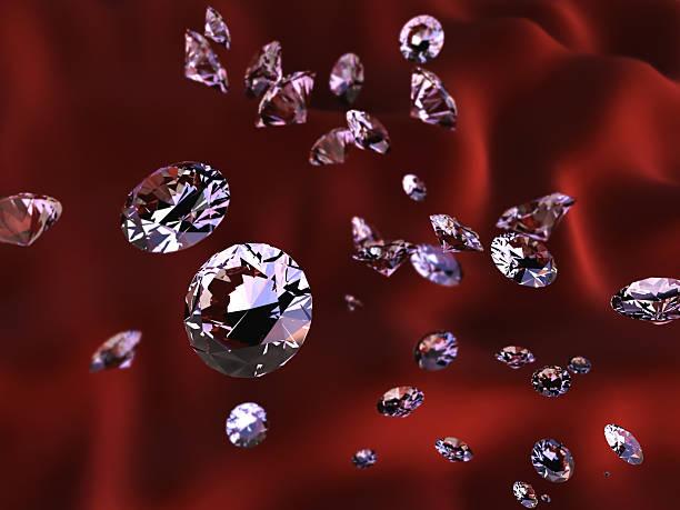 Diamonds on red silk stock photo
