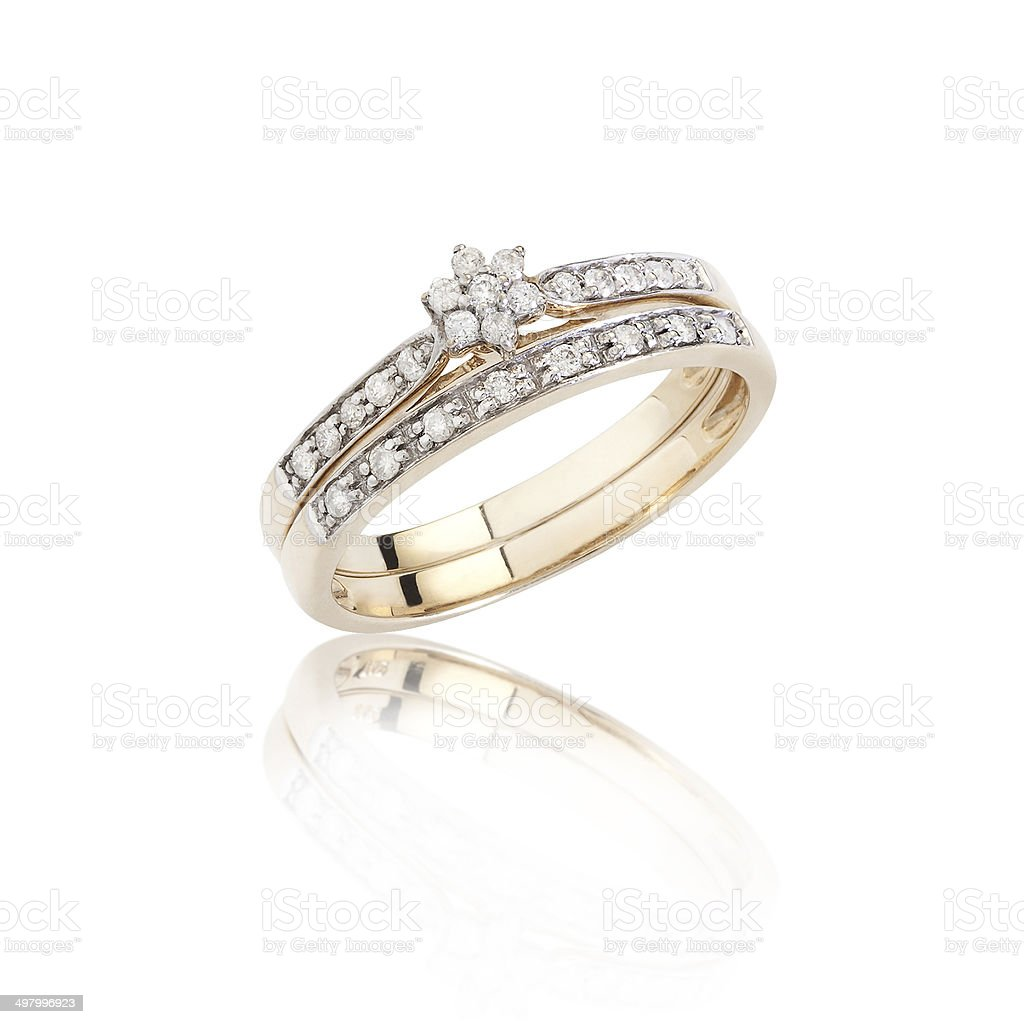 Diamonds ring on golden body shape isolated stock photo