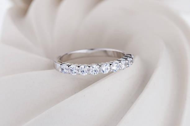 Diamonds wedding ring on white background stock photo