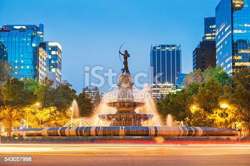 Photo of the landmark Diana the Huntress Fountain (Fuente de la Diana Cazadora) on Paseo de la Reforma avenue in downtown Mexico City, Mexico, at twilight blue hour.