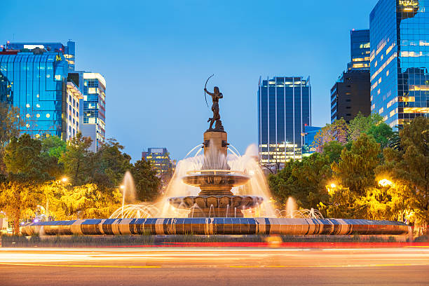 Diana the Huntress Fountain in Downtown Mexico City Photo of the landmark Diana the Huntress Fountain (Fuente de la Diana Cazadora) on Paseo de la Reforma avenue in downtown Mexico City, Mexico, at twilight blue hour. artemis stock pictures, royalty-free photos & images
