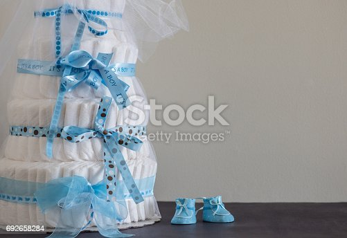 875685464 istock photo Diaper Cake A multi leveled diaper cake for a baby shower. 692658284