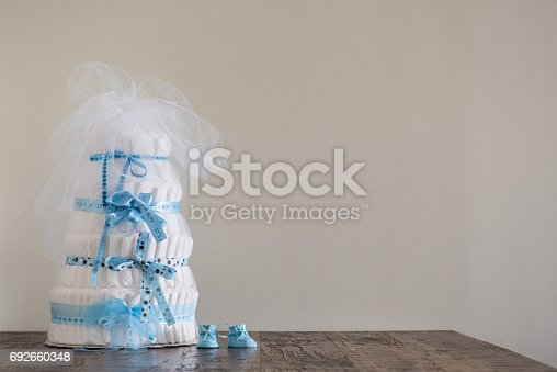 875685464 istock photo Diaper Cake A multi leveled diaper cake for a baby shower. 692660348