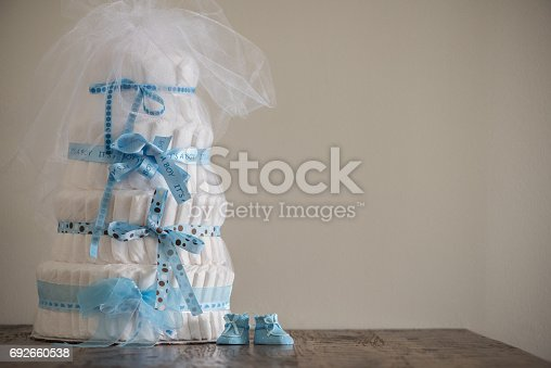 875685464 istock photo Diaper Cake A multi leveled diaper cake for a baby shower. 692660538