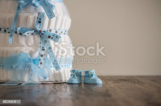 875685464 istock photo Diaper Cake A multi leveled diaper cake for a baby shower. 692660612